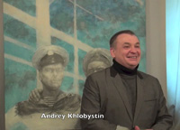 "Andrey Khlobystin, artist and curator in front of Georgy Guryanov's painting ""Self-portrait"" from the 2010s"